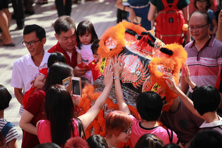 Kuala Lumpur, Malaysia - JANUARY 28, 2017. Local Chinese performing Lion Dance and get throng by the the visiter at Thean Hou Temple during Chinese New Year celebration 2017.