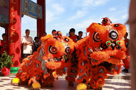 Kuala Lumpur, Malaysia - JANUARY 28, 2017. Local Chinese performing Lion Dance at Thean Hou Temple during Chinese New Year celebration 2017.