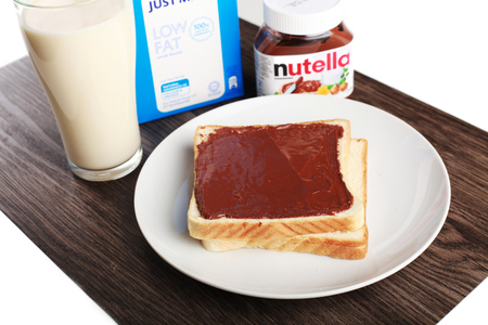 nutella: Shah Alam, Malaysia - FEBRUARY 3, 2017. Oreo biscuit Bread and nutella bread milk in woden and isolated in white background  Illustrative editorial Editorial