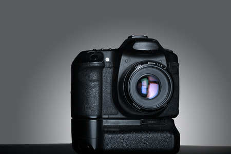 dslr camera shot isolated in gray gradient background in the studio.