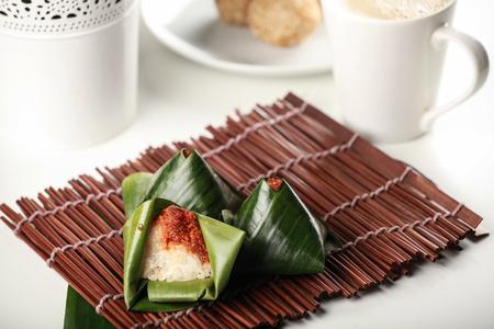 Kuih traditional Malay, pulut inti  with banana leaf