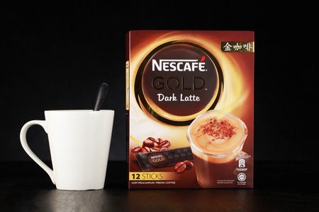 Shah Alam, Malaysia - FEBRUARY 17, 2017  illustrative editorial nescafe gold drink product shot with glass  isolated on black  background