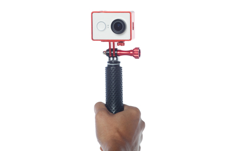 take a selfie using action camera isolated with white background with monopod stick