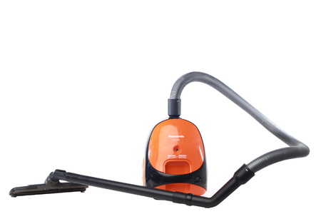 A small home vacuum isolated with white background