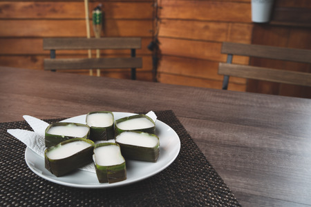 delicious malaysian traditional food lekor and tepung pelita on wood theme background