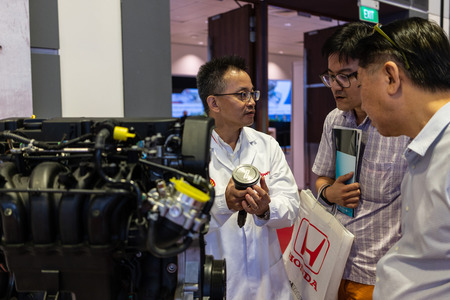 singapore -12 january 2019. shel scientist explaning people about the technology behind the engine at singapore motor show