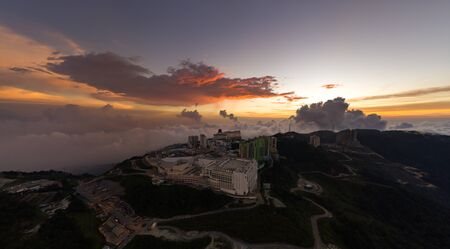Malaysia Genting Highland with sunset and dramatic cloud city above the cloud. noise are existed in a drone photography