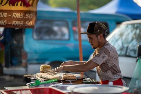 Shah Alam, Malaysia - 9 August 2019. Asian man make a murtabak for sell at street bazaar. 報道画像