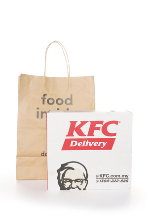 Shah Alam, Malaysia - 1 November 2019, Dah Makan take away paper bag with KFC box isolated on a White background