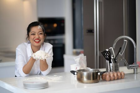 The action of the woman making the bread