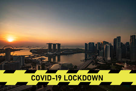 city scape with large covid-19 lockdown sign