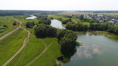 drone flight over the river. beautiful small islands. The settlement near the river