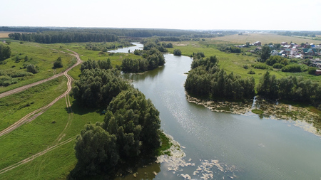 inhabitants: drone flight over the river. beautiful small islands. The settlement near the river
