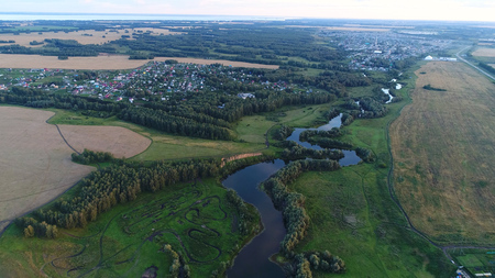 Photos from a height. drone flight over the river. beautiful small islands. The settlement near the river