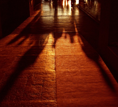 with light shadow: Shadows of Walking People in Sunset