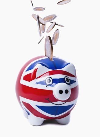 Coins Raining into a British Piggy-Bank Stock Photo - 8958688