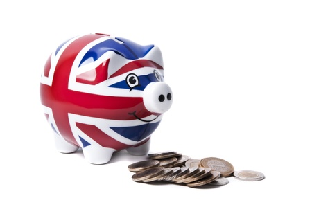 Isolated image of a piggy-bank with British Flag eating coins photo