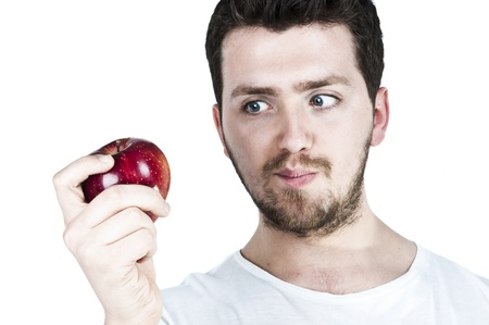 Isolated image of a young man staring at a red apple with hunger Stock Photo - 9069373