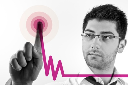 Isolated image of a black and white young business man drawing increasing graphics with magenta line and waves Stock Photo - 9079547
