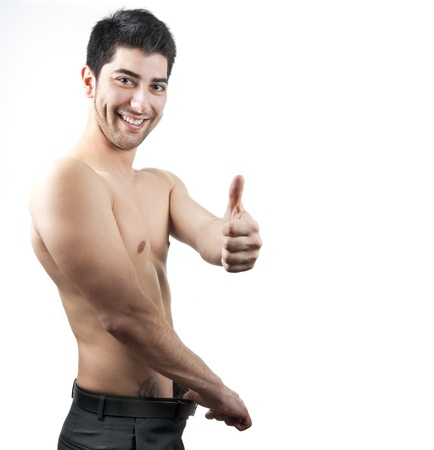 Isolated image of a young handsome man happy with his weight and shape photo