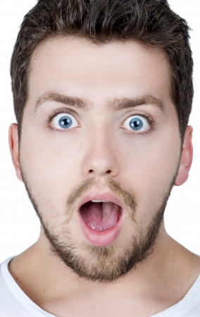 Young blonde man with blue eyes surprised, isolated photo