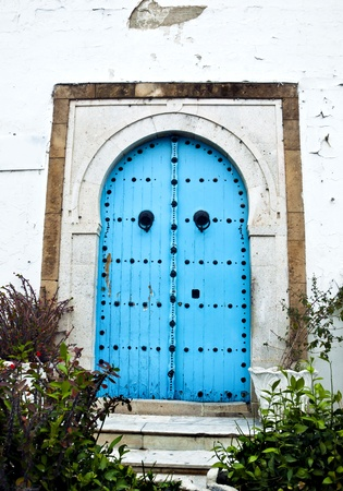 Image of authentic Tunisian blue painted door photo