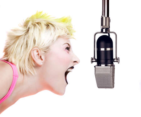 Isolated image of a blonde punk girl shouting at a microphone photo