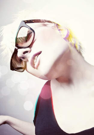 Portrait of a young, blonde girl with short hair and sunglasses Stock Photo - 9410720