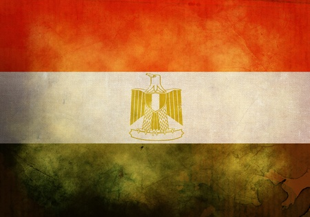Egyptian Flag on old and vintage grunge texture photo