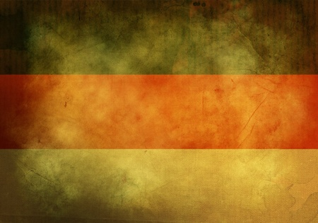 German Flag on old and vintage grunge texture photo