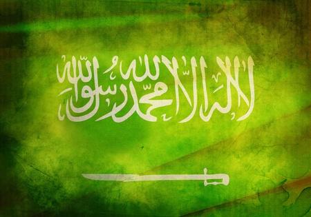 Saudi Arabian Flag on old and vintage grunge texture photo