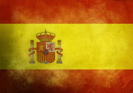 Spanish Flag on old and vintage grunge texture photo