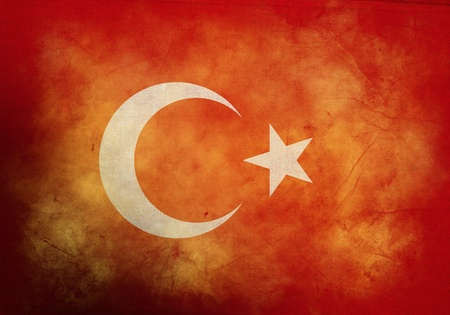 Turkish Flag on old and vintage grunge texture photo
