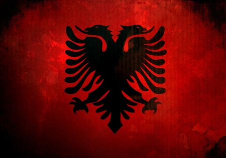 Albania flag on old and vintage grunge texture photo