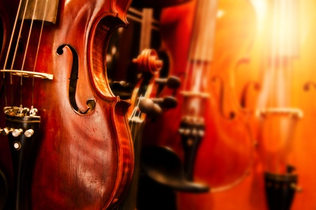 symphony: An enhanced close up image of old violins Stock Photo
