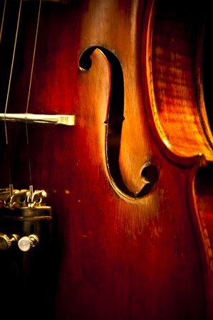 An enhanced close up image of an old violin photo