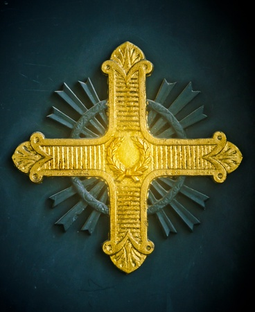 Shining gold cross relief on a Greek Orthodox church in Istanbul, Turkey photo