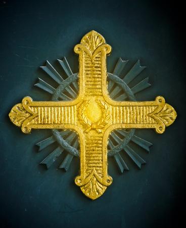 orthodox church: Shining gold cross relief on a Greek Orthodox church in Istanbul, Turkey