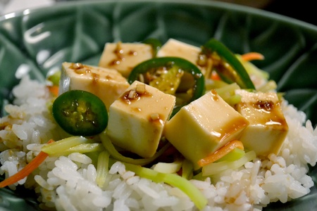 A close up image of Korean vegetarian food with rice, vegetables and soy sauce photo