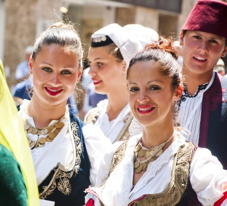albanian: Young people from Balkan countries in a march held in Istanbul, Turkey, traditional dresses