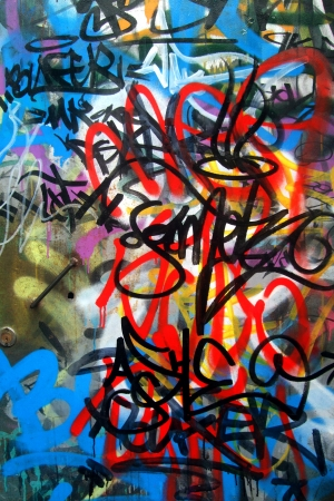 Graffiti tags on metal wall