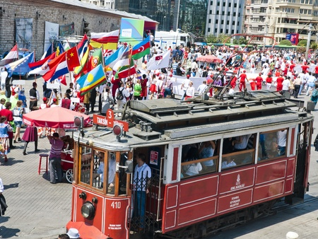 marchers: Young people from all over the world marching with flags in ethnic costumes in Istiklal Road, Taksim, Istanbul, July 16 2011