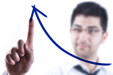 rising: Young business man drawing a rising arrow on a glass board Stock Photo