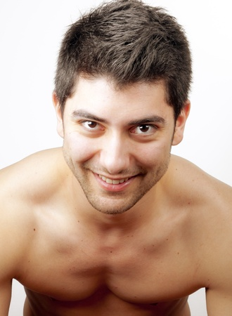portrait of a young happy man over white Stock Photo - 10100029