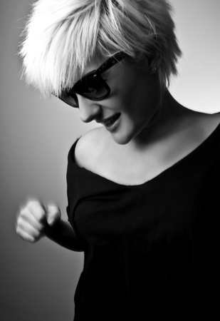 Portrait of a young, blonde girl with short hair and sunglasses Stock Photo - 10162740