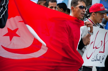 Tunisian people demonstrating after the Jasmin Revolution in the city center