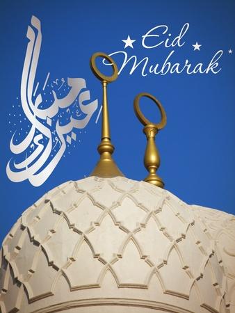 Eid celebration card on Sheikh Zayed mosque in Abu-Dhabi, UAE photo