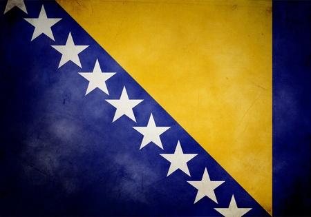 Bosnia and Herzegovina flag on old and vintage grunge texture photo