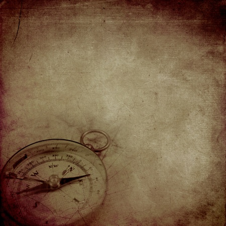 adventure story: Aged paper background with an old compass and map pattern Stock Photo