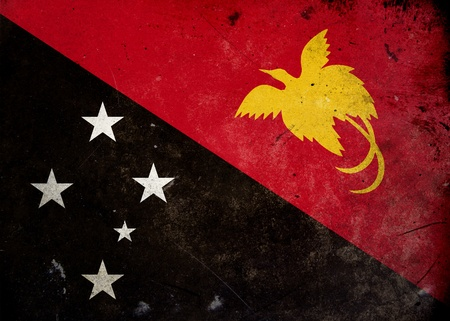 Flag of Papua New Guinea on old and vintage grunge texture photo